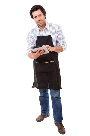 man searching: Young man searching for a new recipe over the internet Stock Photo
