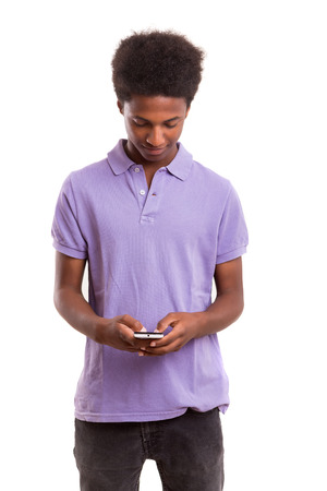 handsome boy: Young african boy at the phone, isolated over white Stock Photo