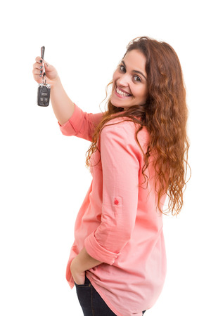 keys isolated: Woman with car key, isolated over white background