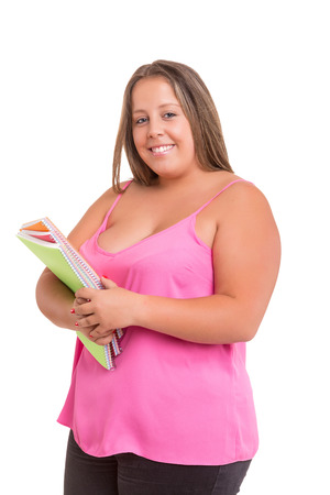 overweight students: A beautiful large student woman, posing isolated over white background