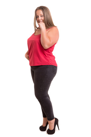 Happy overweighted woman posing isolated over white background Stock Photo