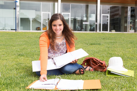 school work: Young woman studying at the university campus