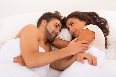 romance sex: A beautiful young passionate couple in bed