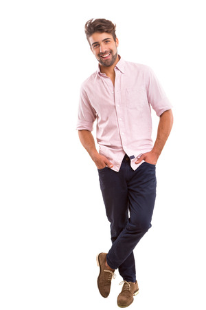 men standing: Studio picture of a young and handsome man posing isolated Stock Photo