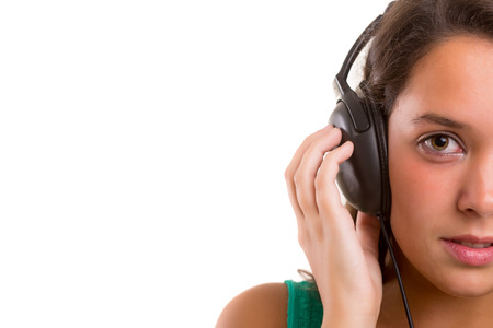 listening: A Happy young woman listening to music