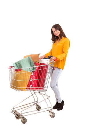 christmas budget: Woman carrying a shopping cart full of gifts