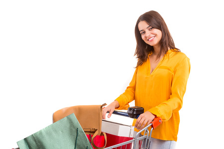 woman shopping cart: Woman carrying a shopping cart full of gifts