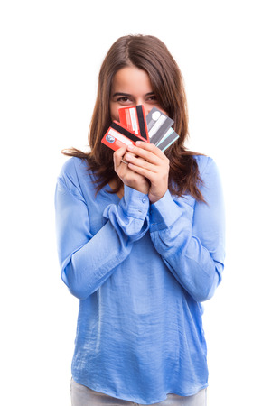 credit card bills: E-commerce concept - Happy woman holding credit cards Stock Photo