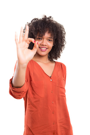 signaling: Beautiful african young woman signaling ok, isolated over white