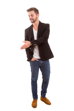 Young man presenting your product, isolated over a white background photo