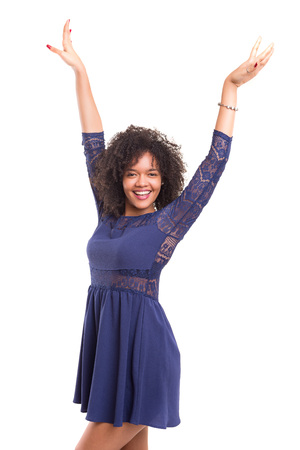 african women: Studio shot: Happy African woman with raised arms Stock Photo