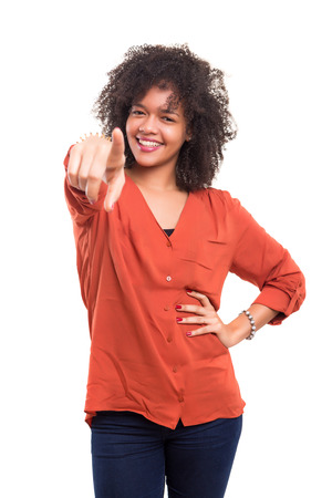 mixed race woman: Young beautiful african woman pointing at you, isolated over white