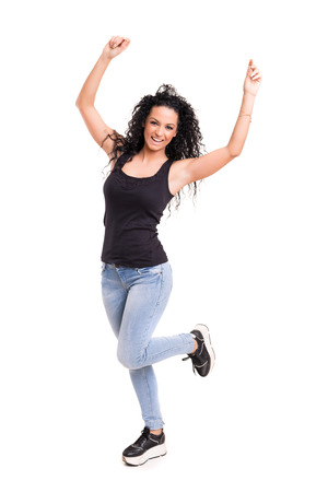 raised arms: Studio shot: Happy woman with raised arms Stock Photo