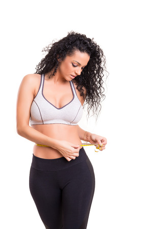 woman measuring: Woman measuring her body - fitness concept