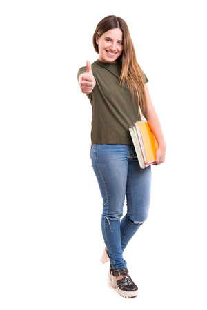 one people: Studio shot of a young woman carrying some books