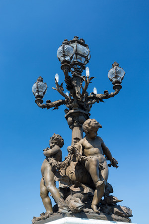 Lamp in the beautiful Alexander III bridge in Paris