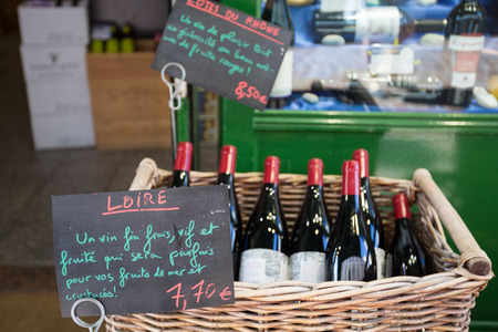 afternoon break: French wine on sale at the market of Rue Mouffetard Stock Photo