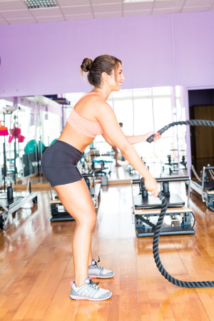 training session: Young woman getting into shape with one more training session