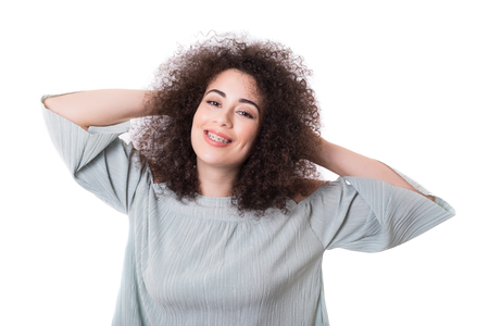 bracket: Happy young woman - who weares braces - posing isolated over white Stock Photo