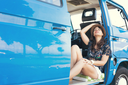 summer holidays, road trip, travel and people concept, young woman resting in minivan car Stock Photo