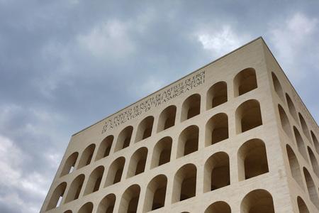 Palazzo della Civilta Italiana (Square Colosseum) in Rome, Italy. The inscription reads: