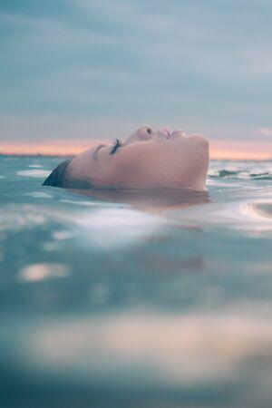 Asian model in the water enjoying a wellness spa.
