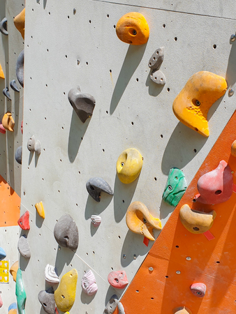 Indoor and outdoor sports climbing stone wall.