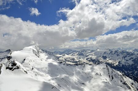 Austria europe mountain tops with snow on it and clouds