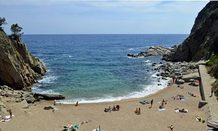 Sunny image of the spanish beach ocean and cliffs in the nature. Zdjęcie Seryjne