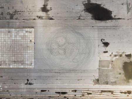 Asphalt with skid marks tire marks burnout black on concrete