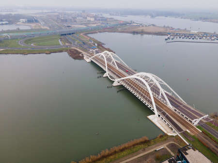 Aerial drone video of the Enneus Heermabrug in Amsterdam, The Netherlands going to Ijburg and Steigereiland Amsterdam Oost east. Foto de archivo