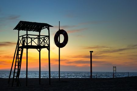 lifeguard watchtower in the beach, at the sunset