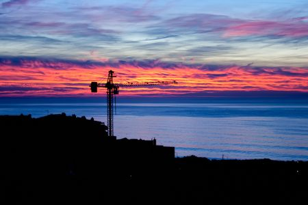 construction site view at the sunset over the sea