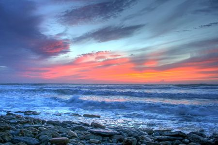 beautiful red sunset in a rocky coastline Stock Photo - 5919389