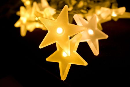 Christmas lights decoration closeup in isolated background black