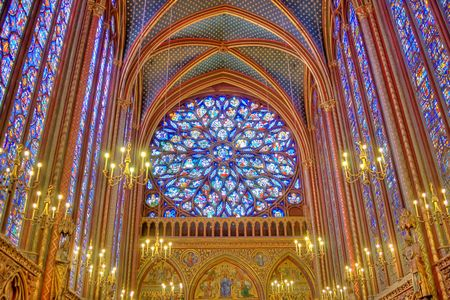 catholic stained glass: view of stained glass windows and rosacea with chandelier