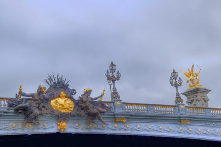 view of ornamented bridge with classical statues and lamps