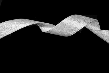 spiraling: silver ribbon isolated in a black background