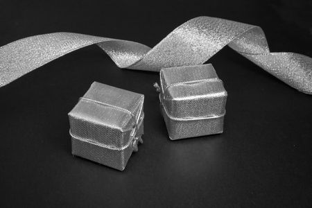silver ribbon and boxes isolated in a black background