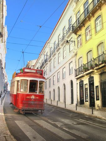 lisbon traditional electric tram descending an old street Stock Photo