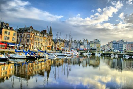 day view of the old ports Honfleur, with multicolored historic buildings facades photo
