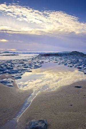 small water strams into a pond in the atlantic coastline Stock Photo