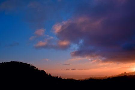 beautiful warm sunset in a dark horizon