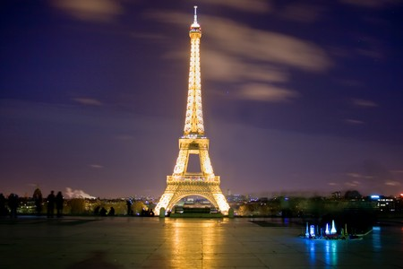 night view of the eiffel tower with mini towers