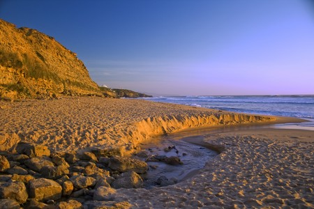 portuguese west coast beach, as viewed in the sunset