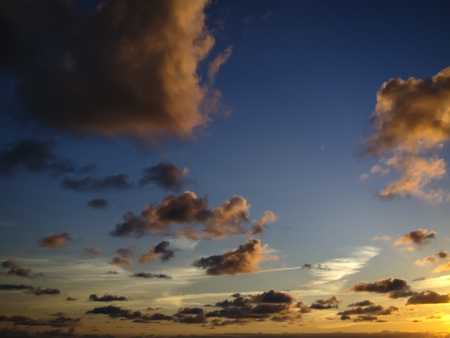 cloudy and multicolored sunset as seen in Portugal atlantic coast Stock Photo