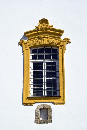old yellow window isolated in white wall Stock Photo