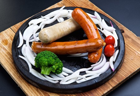 sizzling: Sizzling sausage Stock Photo