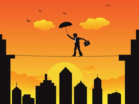 A businessman walking on the high wire tightrope at sunset scene