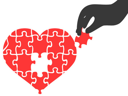 Isolated hand took heart jigsaw puzzle piece on white background